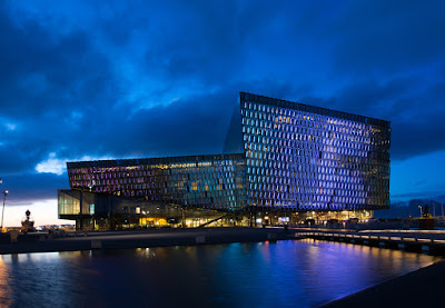 Reykavik's Harpa Concert Hall at dusk is a popular sightseeing attraction