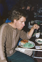 A man eating green eggs and ham.