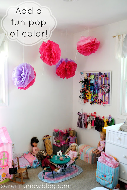 Hang Tissue Paper Pom Poms from the Ceiling for a Pop of Color, from Serenity Now