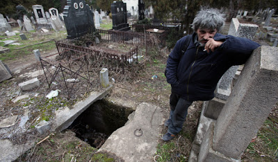 man lives in cemetery