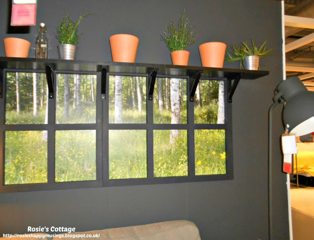 faux windows and forest meadow under shelves holding plants