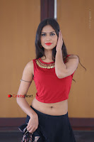 Telugu Actress Nishi Ganda Stills in Red Blouse and Black Skirt at Tik Tak Telugu Movie Audio Launch .COM 0380.JPG