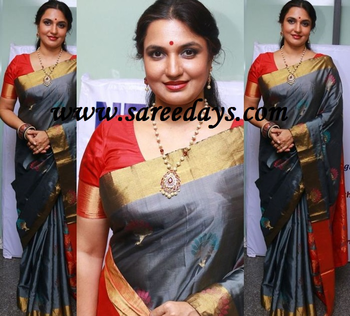 Latest saree designs suganya in gray silk saree checkout suganya in gray silk saree with gold border and paired with contrast red short sleeves blouse altavistaventures Image collections