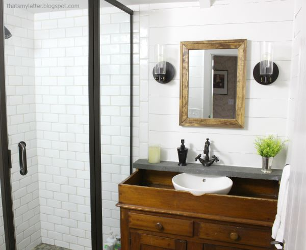 white tile dark metal bathroom