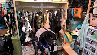 baby carriers hanging at childish things baby consignment store