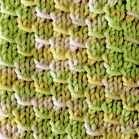 Pangolin Scales Knitting Sttich in the round. Easy stitch pattern with a 4-row repeat.
