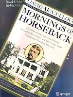 Mornings on Horseback, by David McCullough, superimposed on Intermediate Physics for Medicine and BIology.