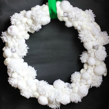 Make a pom pom snowball wreath