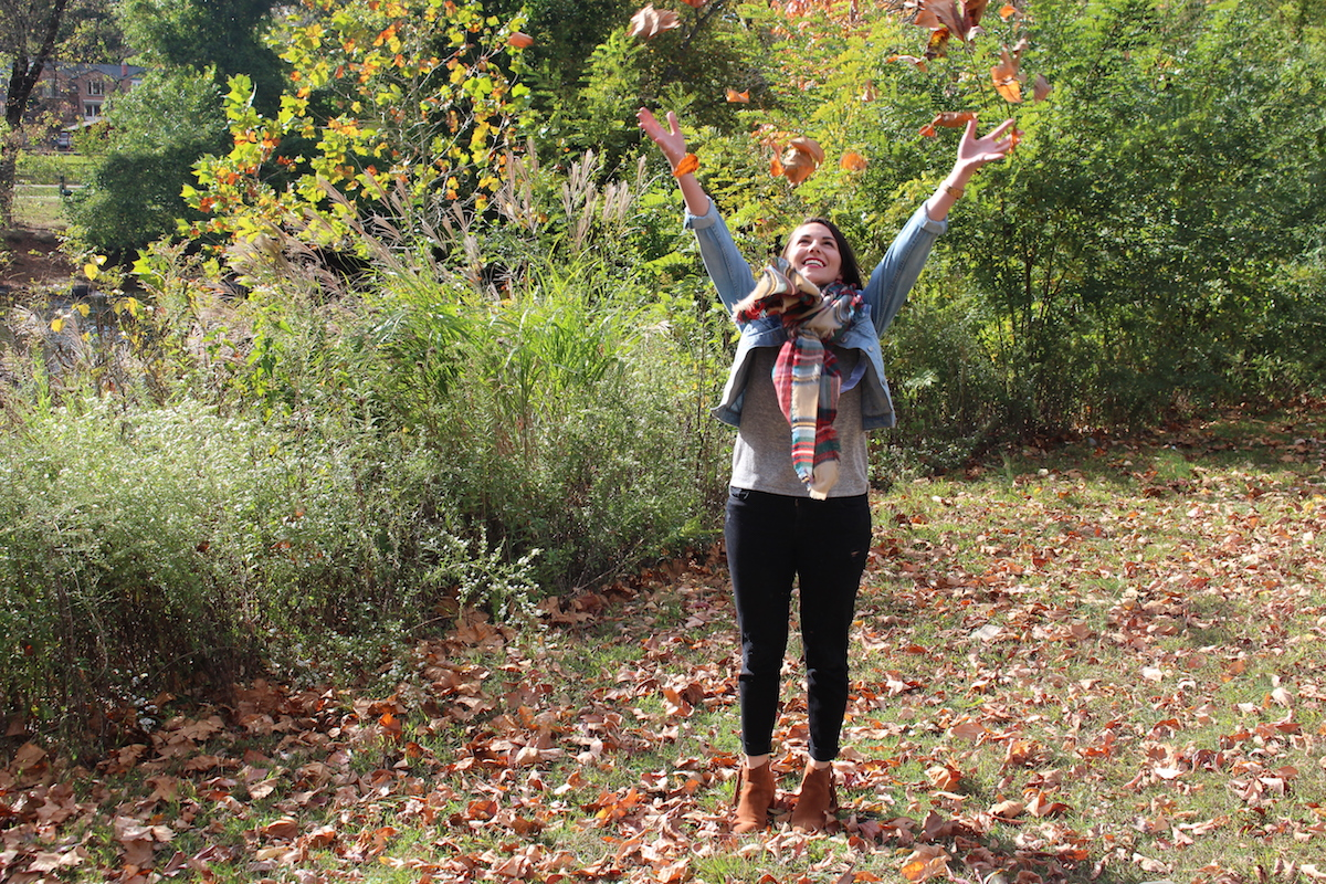 In this photo, I am throwing leaves into the air in Brandywine Park and I look ridiculously happy.