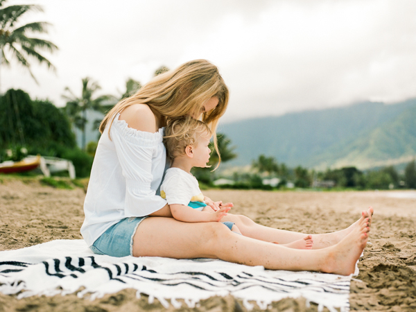 Mother-son moment on the beach in Hanalei Bay, Kauai