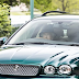 See 91 year old Queen Elizabeth II photographed driving a green Jaguar after Church services