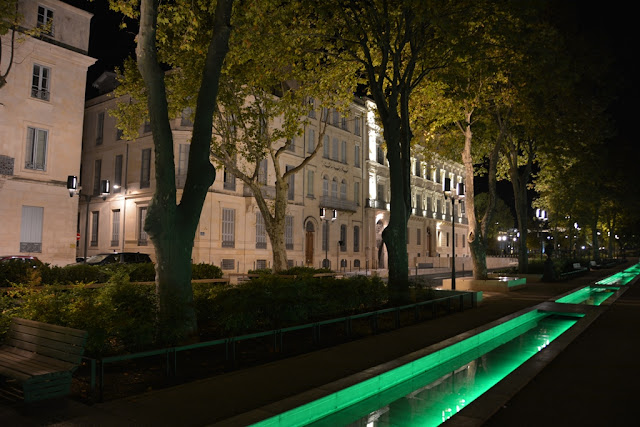 Nimes green water by night