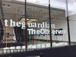 Pic of Guardian and Observer window at entrance in Kings Place, London N1