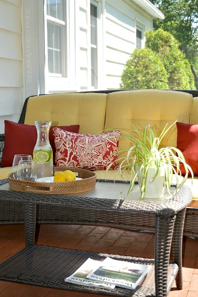 Screened in porch with wicker furniture