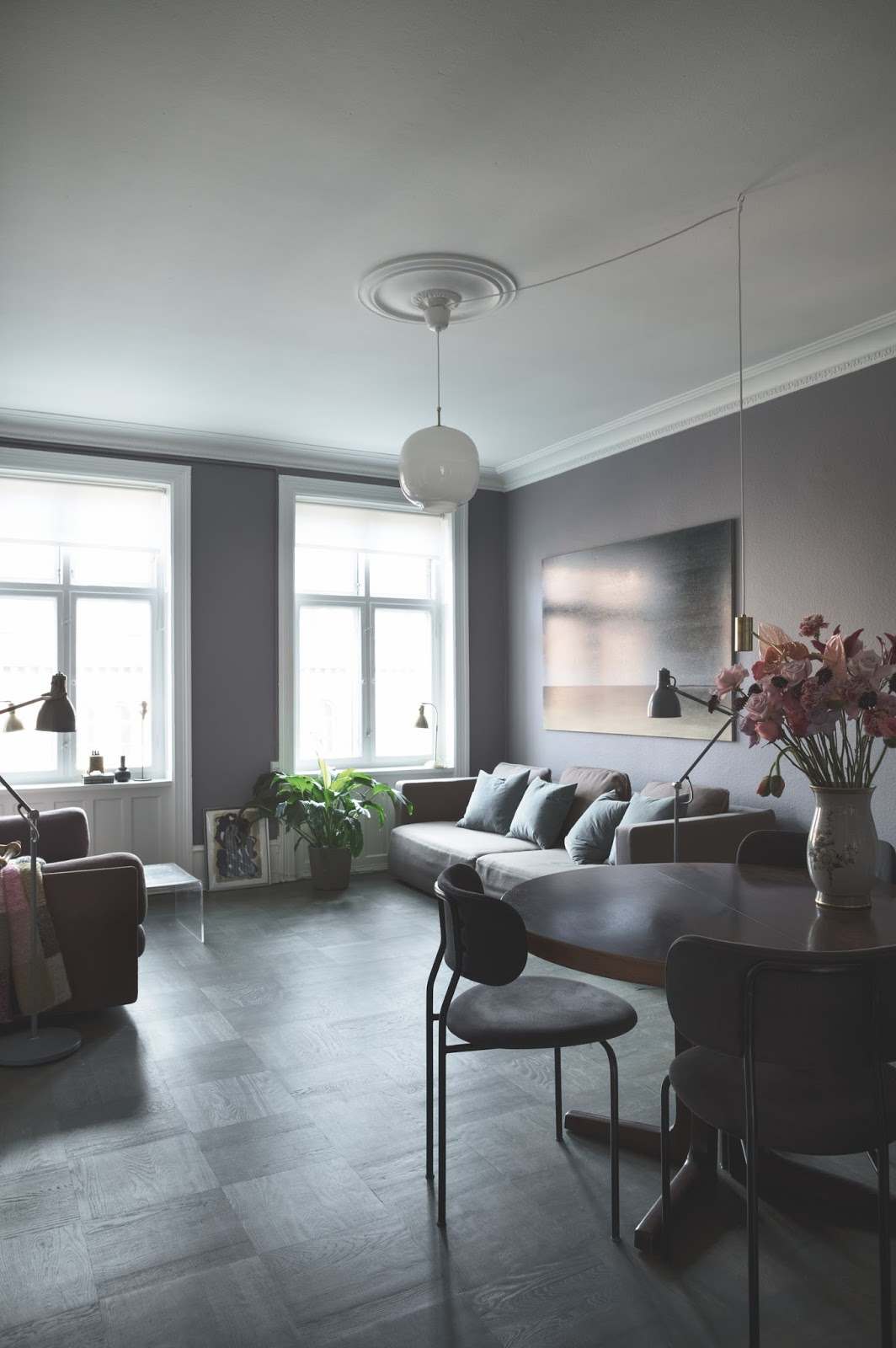 living room in the dark painted scandinavian apartment