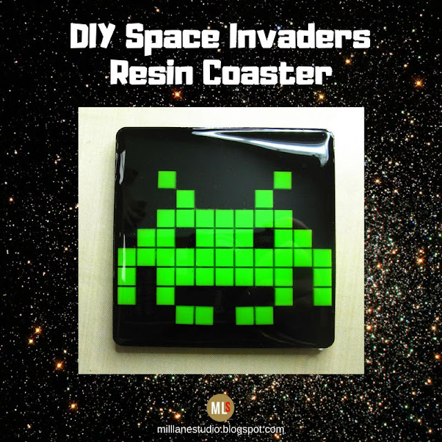 Space Invaders Resin coaster with green alien on black background