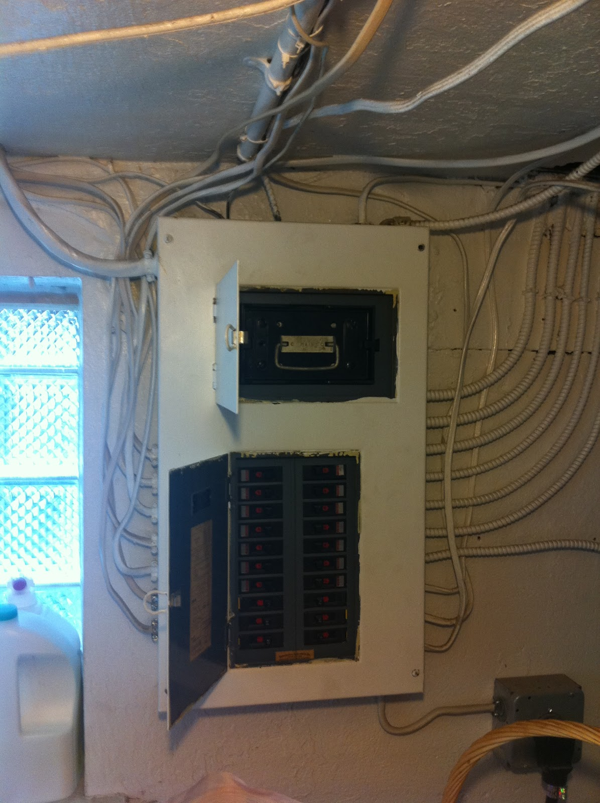 small resolution of this panel is a combination main electrical fuse with circuit breaker on the branch circuits the top black box with the silver metal handle is the box that