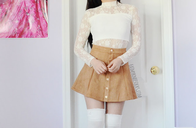Details on the tan faux suede button-down a-line skirt from Allegra-K, worn with a Snidel Japanese mock-neck lace crop top and over-the-knee socks.