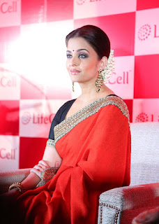 Aishwarya Rai Red Saree Sitting Pose