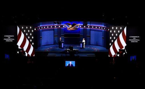 Republican-US-presidential-nominee-Donald-Trump-speaks-as-Democratic-US-presidential-nominee-Hil