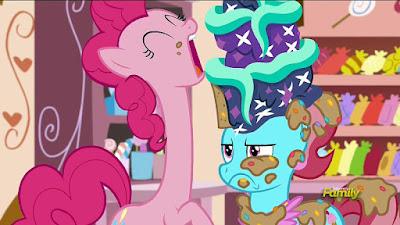 Pinkie eats a cake. A very tall cake.
