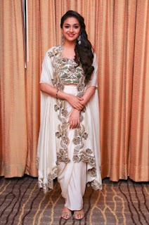 Keerthy Suresh in white Dress with Cute Smile in Saamy Square Audio Launch