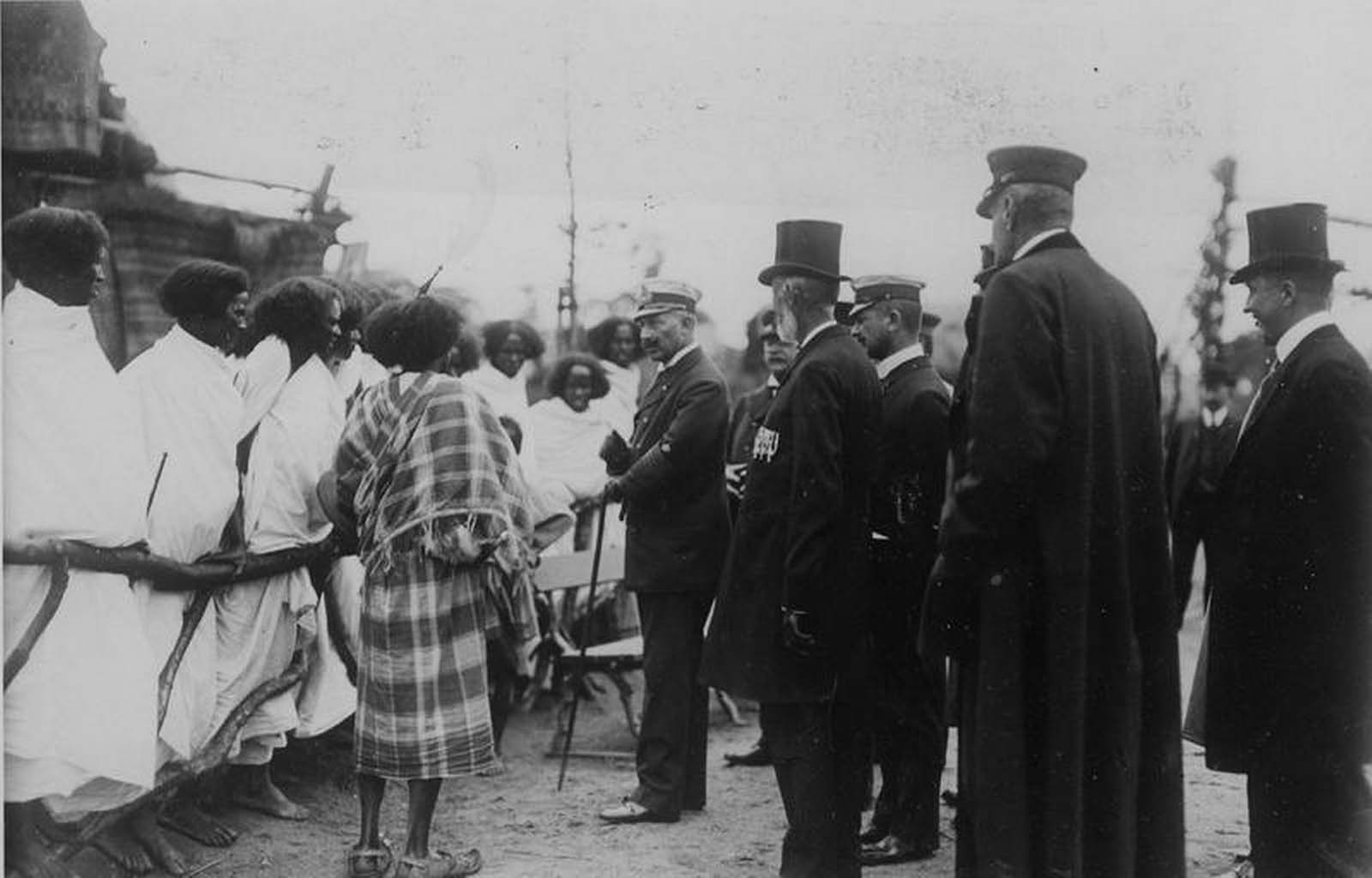 Germany's Kaiser Wilhelm II is pictured meeting Ethiopians standing behind a wooden fence in Hamburg, Germany in 1909.