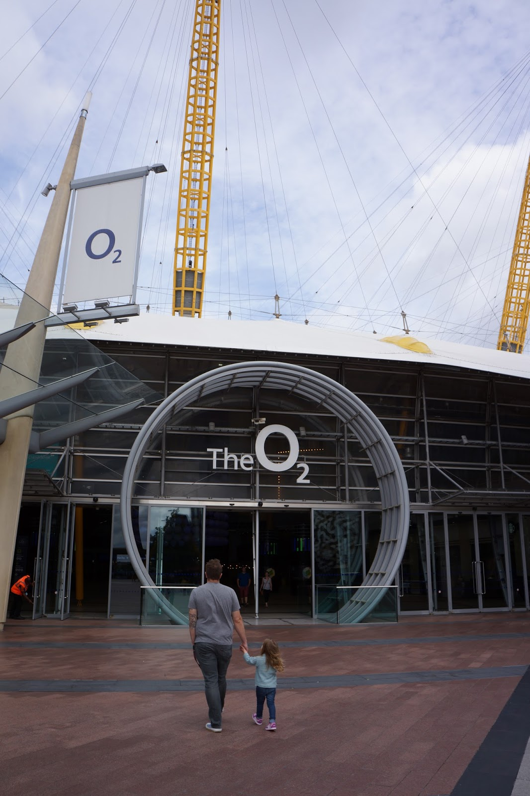 father and child walking toward the o2 entrance