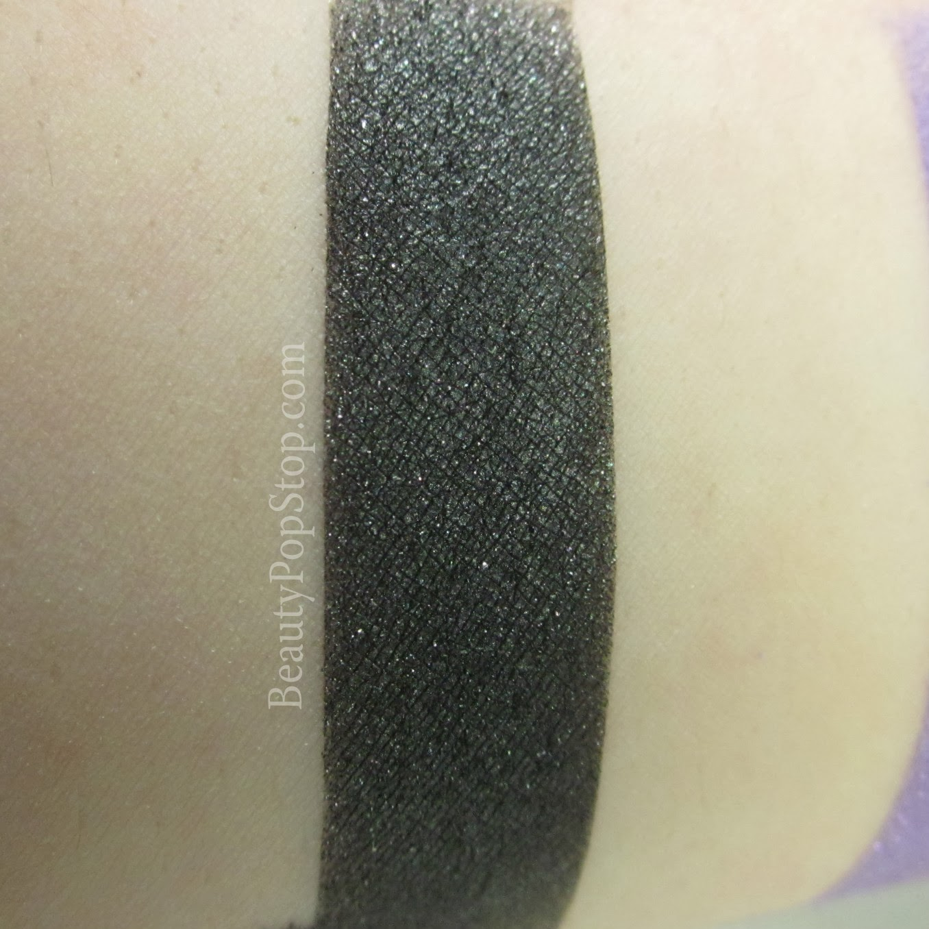 sugarpill soot and stars pressed shadow swatch