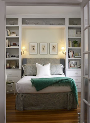 bed surrounded by built-ins
