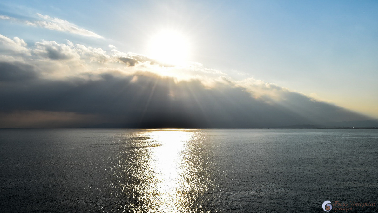 Sunrise behind the clouds at Enoshima, Japan : Focus Viewpoint