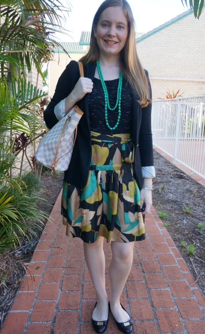 subtle print mixing office outfit silk a-line skirt with black tee and jersey blazer, green and black | away from blue