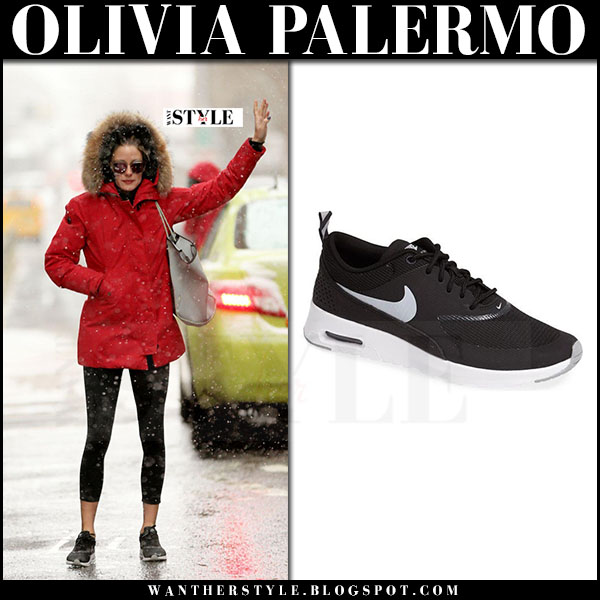 Olivia Palermo in red fur hood parka canada goose, black leggings and black sneakers nike air max thea what she wore