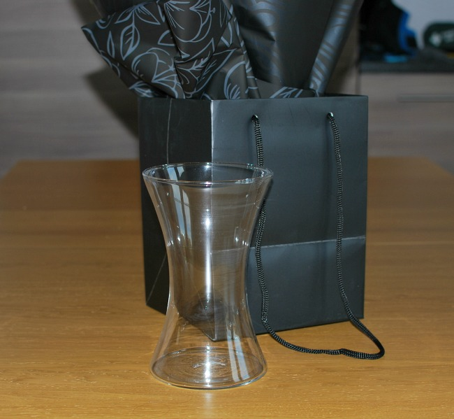 Prestige-Flowers-black-bag-with-waisted-glass-vase-in-front