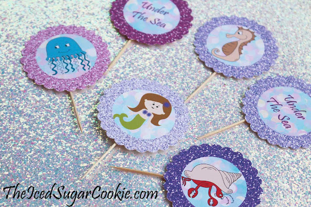 DIY Mermaid Under The Sea Birthday Party Printables-Food Label Tent Cards, Cupcake Toppers, Flag Garland Hanging Banner-Purple Glitter Digital Download Template-Seahorse, Jellyfish, Hermit Crab Chocolate Sea Shells, Fish Eggs, Ocean Waves, Mermaid Sandwiches How many Pearls, Take A Guess, Guess How Many Seashells, How Many?