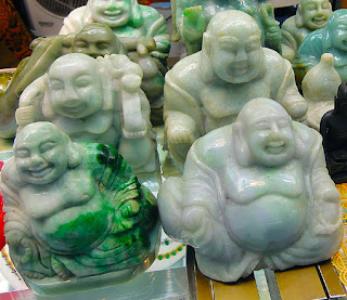some simple white green Buddhas