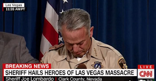 Vegas sheriff changes Mandalay massacre timeline AGAIN and says shooter DIDN'T shoot hotel security guard six minutes before rampage as he breaks down on camera