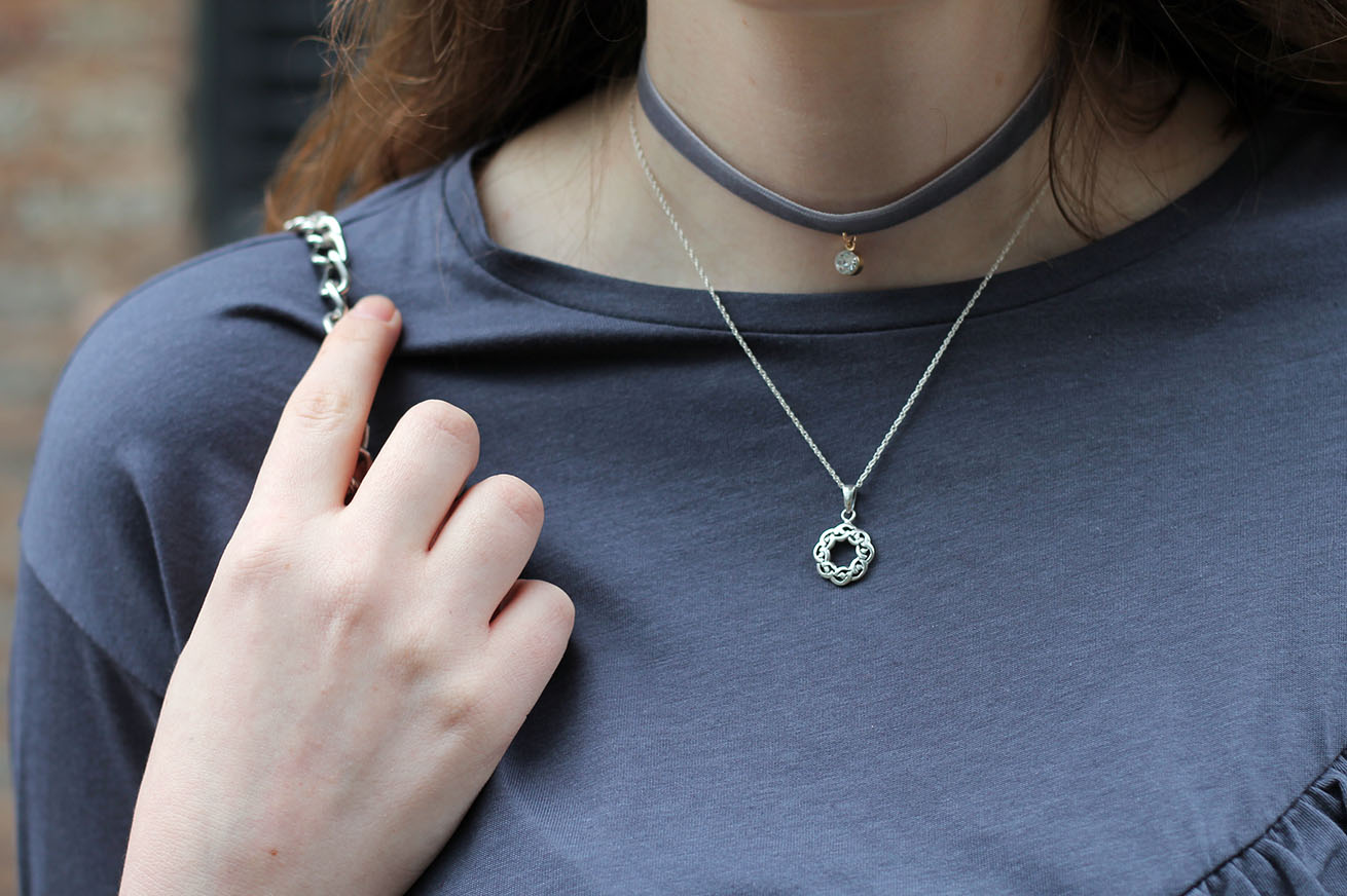 Liverpool fashion blogger, silver celtic knot necklace, grey velvet choker with charm and grey ruffle top