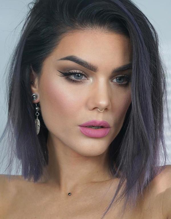 wearing pink lipstick