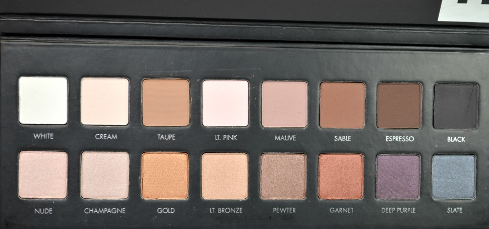 Eyeshadow palette open showing the shades inside.