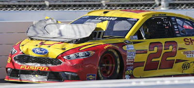 Pole-winner, Joey Logano struggled for much of the day and finished 11th. Crossed the finish line with his hood bent back, partially obstructing his view.