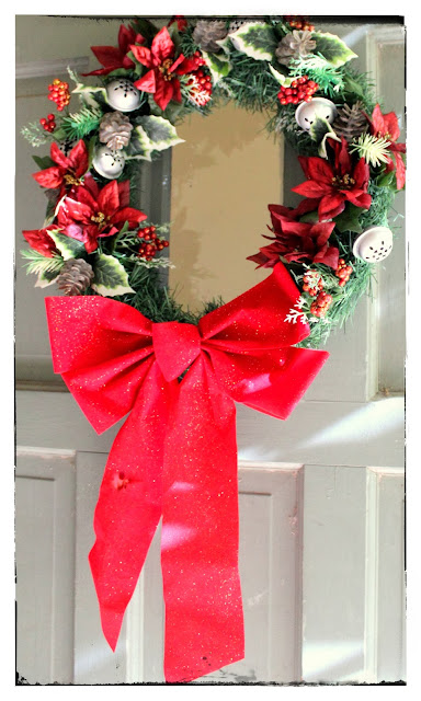 Green and red holiday wreath with pine garland