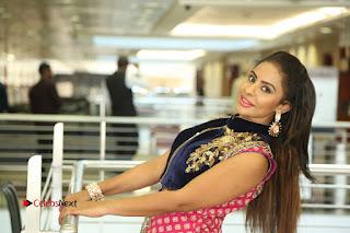 Telugu Actress Sri Reddy Mallidi Stills in White Beautiful Dress at Marriage Needs Bridal Fashion Week 2017 Logo Launch  0198.JPG