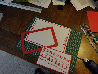 Red and white triple stamped knitting design - under construction
