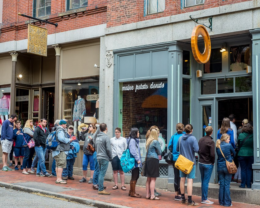 Portland, Maine USA May 2017 photo by Corey Templeton of Holy Donut on Exchange Street with long long for morning donuts and coffee.