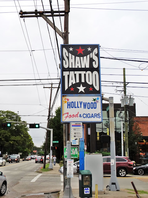 Shaw's Tattoos & Hollywood Food & Cigars on corner of Westheimer and Dunlavy