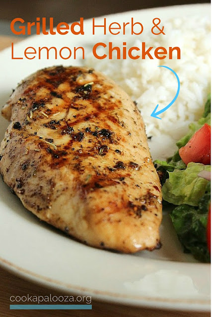 Grilled Herb and Lemon Chicken on a plate with salad and rice