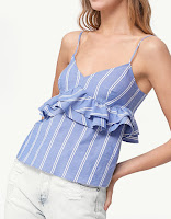 https://www.stradivarius.com/be/nl/dames/kleding/best-of-sale/top-met-schouderbandjes-en-volants-c1707501p300219533.html?colorId=046