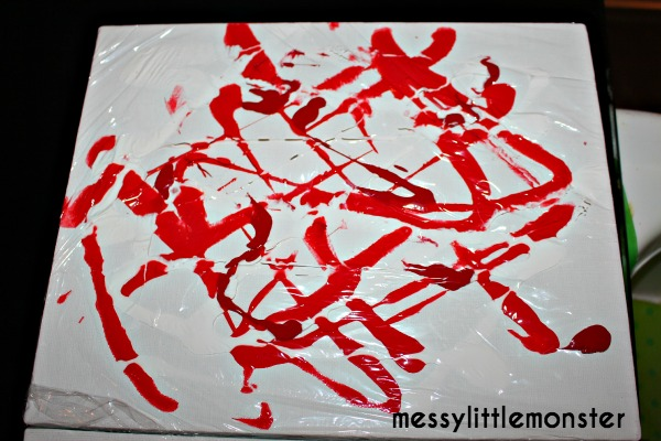 Easy painting ideas for kids. Cling film canvas wall art. No mess painting for babies, toddlers and preschoolers.