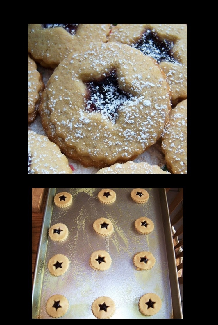 cut out cookies on a cookie sheet ready for baking with raspberry jam filling and a shortbread dough baked cookies with powdered sugar on top usually called linzer cookies